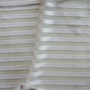 Striped sheer fabric by the yard. Novelty fabric sold online by the yard. Many styles and colors, all available at no minimum order. Novelty stretch fabrics sold by the yard or roll. Perfect for dance, swim, cheer, bows, gymnastics, figure skating, costume, cosplay, apparel and more. Fabric sold by the yard or roll at no minimum.