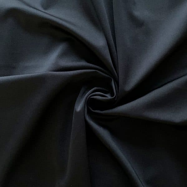Shiny Black Tricot Fabric - Carvico Sumatra Nylon Lycra 4 way stretch fabric for swim - Solid Stone Fabrics, Inc.