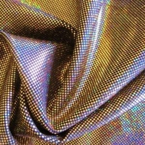 Gold medium dot hologram spandex fabric featuring black stretch base fabric topped with gold holographic foil, for brilliant shine and sparkle.