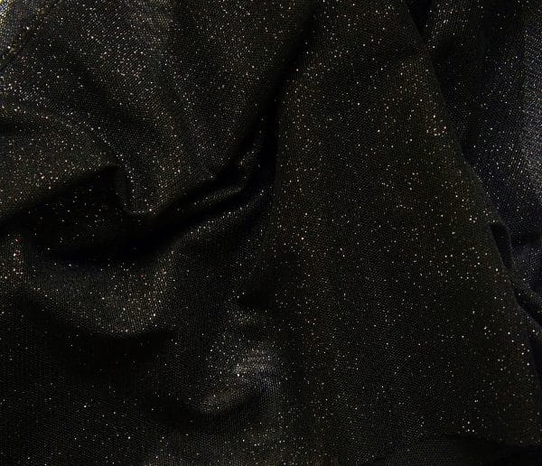 Black Glitter Mesh fabric features all over black glitter on 2-way stretch black polyester mesh making it ideal for both semi-fitted and draped garments.