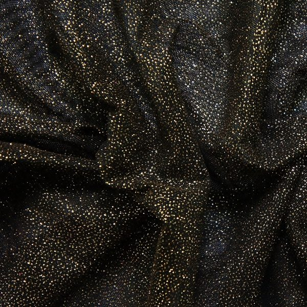 Black Gold Glitter Mesh fabric features all over gold glitter on 2-way stretch black polyester mesh making it ideal for both semi-fitted and draped garments.