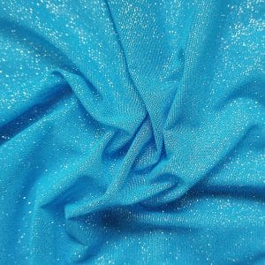 Ocean Blue Glitter Mesh fabric features all over silver glitter on 2-way stretch ocean blue polyester mesh making it ideal for both semi-fitted and draped garments.