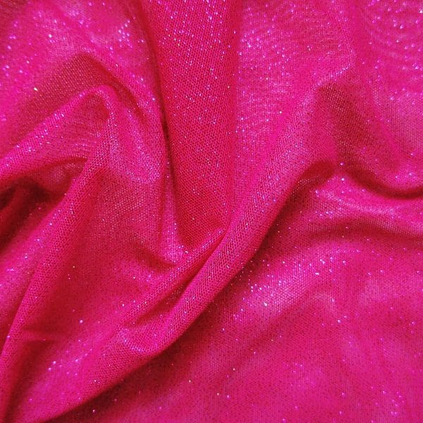 Hot Pink Glitter Mesh fabric features all over hot pink glitter on 2-way stretch hot pink polyester mesh making it ideal for both semi-fitted and draped garments.