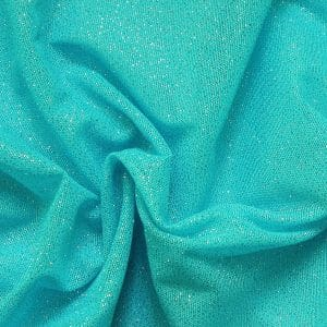 Turquoise Glitter Mesh fabric features all over turquoise glitter on 2-way stretch turquoise polyester mesh making it ideal for both semi-fitted and draped garments.