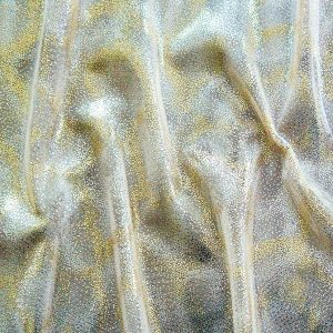 Fairydust Ivory Foil Mesh Fabric features an enchanting gold foil pattern on sheer, teal non-stretch mesh base fabric for a soft, dreamy glow.