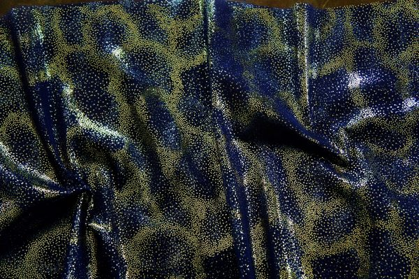 Fairydust Navy Foil Mesh Fabric features an enchanting gold foil pattern on sheer, navy non-stretch mesh base fabric for a soft, dreamy glow.