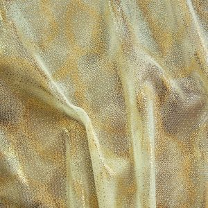 Fairydust Nude Foil Mesh Fabric features an enchanting gold foil pattern on sheer, nude non-stretch mesh base fabric for a soft, dreamy glow.