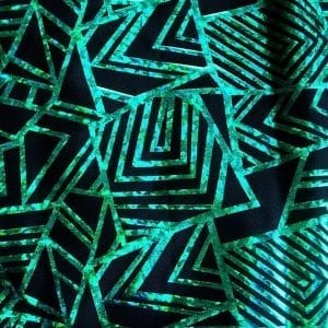 "Kelly Green Geometric stretch fabric features bold geometric designs in ""Broken Glass"" hologram foil on black stretch base fabric for a stunning contrast effect.  - SOLID STONE FABRICS, INC."