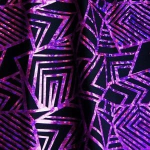 "Purple Geometric Stretch fabric features bold geometric designs in ""Broken Glass"" hologram foil on black stretch base fabric for a stunning contrast effect.  - SOLID STONE FABRICS, INC."