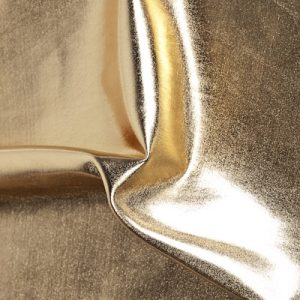 Liquid Foil - Gold Stretch Lame fabric features full coverage metallic foil on 4 way stretch base fabric for an intense liquid shine effect.