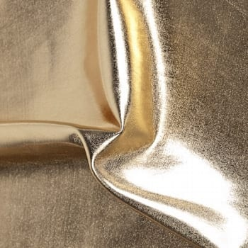 Liquid lame stretch fabric. Metallic foil stretch fabric available in multiple colors. Perfect for dance, recital, costume, theater, costume and more. Shiny stretch fabrics sold by the yard or roll. Huge selection of stretch fabric foils and metallics in a variety of styles, finishes and colors. Perfect for dance, cheer, bows, gymnastics, figure skating, costume, cosplay, apparel and more.