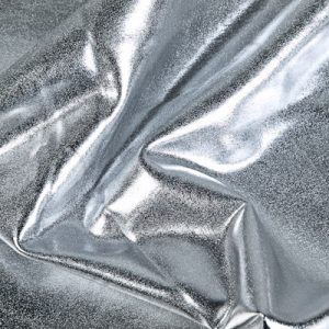Our Liquid Foil - Silver Stretch Lame fabric features full coverage metallic foil on 4 way stretch base fabric for an intense liquid shine effect.