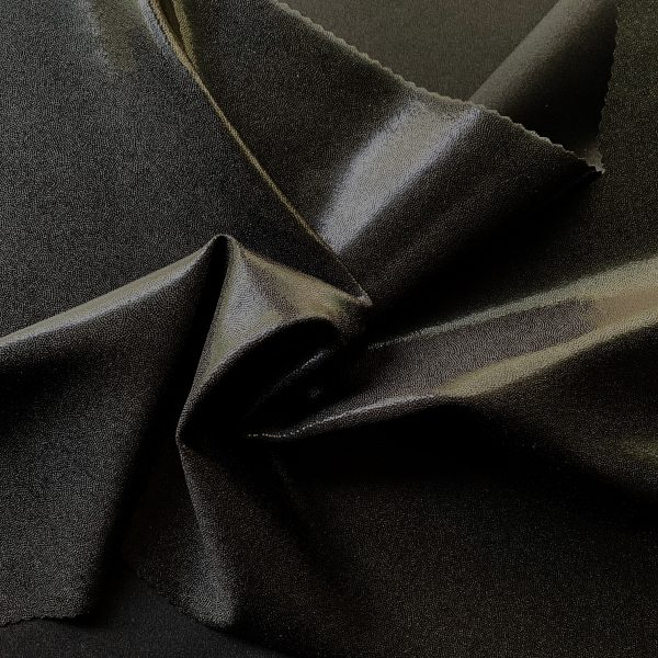 Black Mystique Spandex Fabric is perfect for dance, cheer, bows, gymnastics, figure skating, costume, cosplay, apparel and more.
