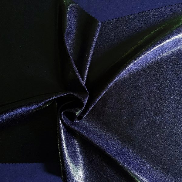 Black Navy Mystique Metallic Fabric is perfect for dance, cheer, bows, gymnastics, figure skating, costume, cosplay, apparel and more.