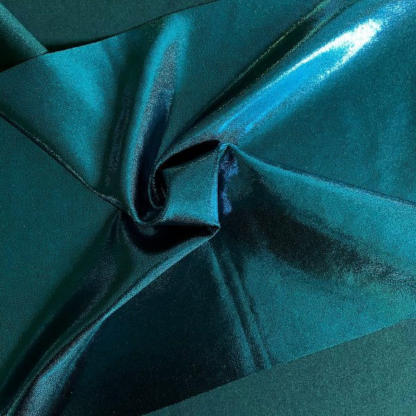 Turquoise Mystique Foil Fabric is perfect for dance, cheer, bows, gymnastics, figure skating, costume, cosplay, apparel and more.