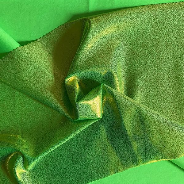 Lime Green Mystique Spandex Fabric is perfect for dance, cheer, bows, gymnastics, figure skating, costume, cosplay, apparel and more.