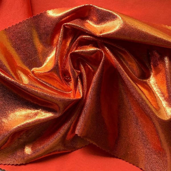Orange Mystique Spandex Fabric is perfect for dance, cheer, bows, gymnastics, figure skating, costume, cosplay, apparel and more.