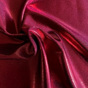 Burgundy Mystique Spandex Fabric is perfect for dance, cheer, bows, gymnastics, figure skating, costume, cosplay, apparel and more.