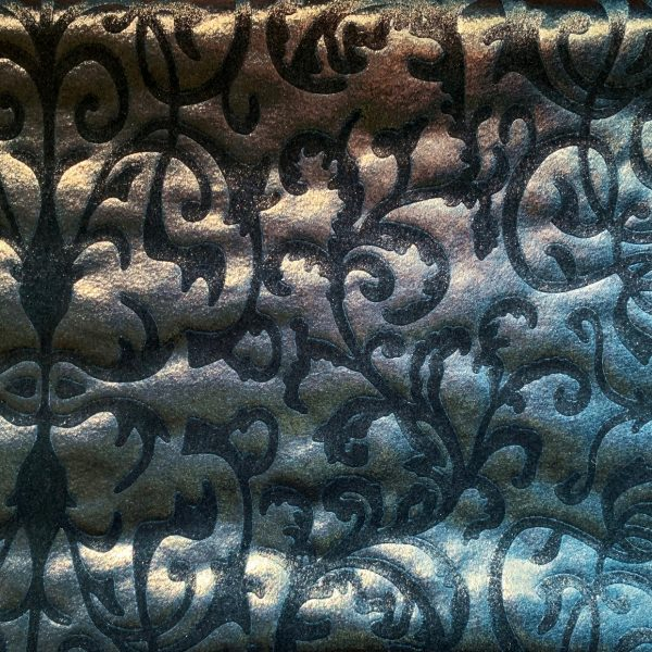 Our Princess Velvet - Blue Green Embossed Stretch Velvet Fabric features a plush nap and rich colors for a luxurious look and feel. Embossed floral motif and subtle gold sheen adds an elegant touch.