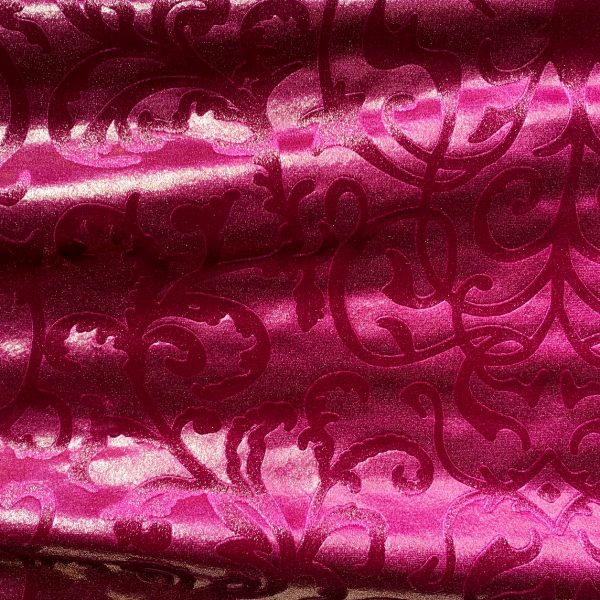 Our Princess Velvet Pink Embossed Velvet Fabric features a plush nap and rich colors for a luxurious look and feel. Embossed floral motif and subtle gold sheen adds an elegant touch.