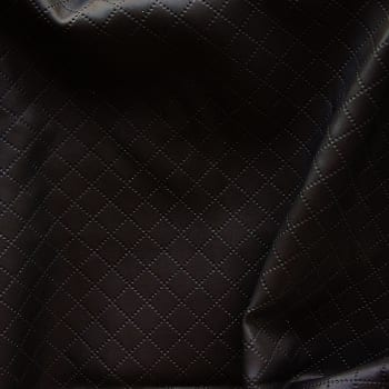 Quilted faux leather fabric by the yard. Diamond quilting stitches on stretch fabric for lots of textural interest. Novelty fabric sold online by the yard. Many styles and colors, all available at no minimum order. Novelty stretch fabrics sold by the yard or roll. Perfect for dance, swim, cheer, bows, gymnastics, figure skating, costume, cosplay, apparel and more. Fabric sold by the yard or roll at no minimum.