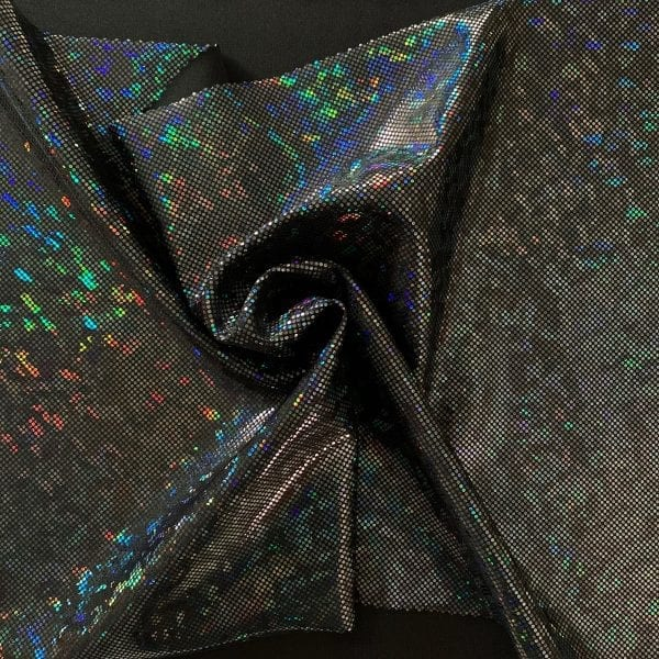 Black broken glass fabric featuring black stretch base fabric topped with black shattered glass holographic foil, for brilliant shine and sparkle.