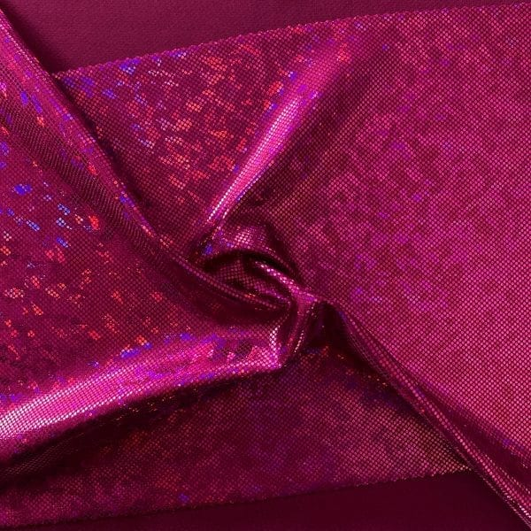 Fuchsia broken glass fabric featuring Fuchsia stretch base fabric topped with Fuchsia shattered glass holographic foil, for brilliant shine and sparkle.