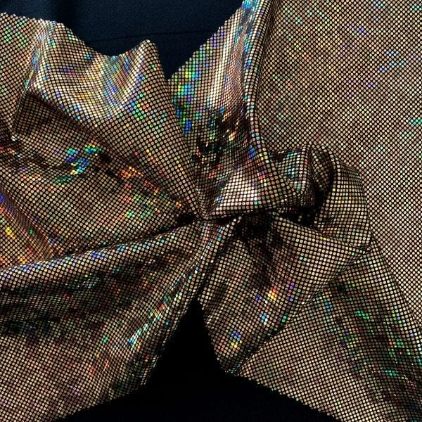 Gold Shattered glass fabric featuring black stretch base fabric topped with gold shattered glass holographic foil, for brilliant shine and sparkle.
