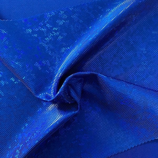Royal blue broken glass fabric featuring royal blue stretch base fabric topped with royal blue shattered glass holographic foil, for brilliant shine and sparkle.