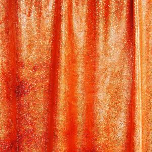 Spectacular - Orange Glitter Tie Dye features tie dye stretch fabric topped with silver foil glitter for brilliant sparkle and shine.