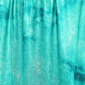 Turquoise Glitter Tie Dye fabric features turquoise tie dye stretch fabric topped with silver foil glitter for brilliant sparkle and shine.