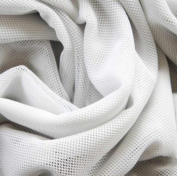 White Fishnet Mesh fabric is super soft, stretchy and features a smaller scale classic fishnet style mesh - SOLID STONE FABRICS, INC.