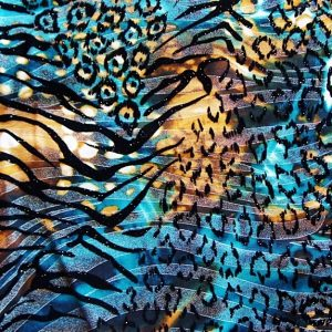 Turquoise Flocked Animal Print fabric featuring an exotic blend of vivid colors and multi animal prints topped with sheer silver foil and bold black flocking, on our premium polyester spandex blend stretch base fabric.