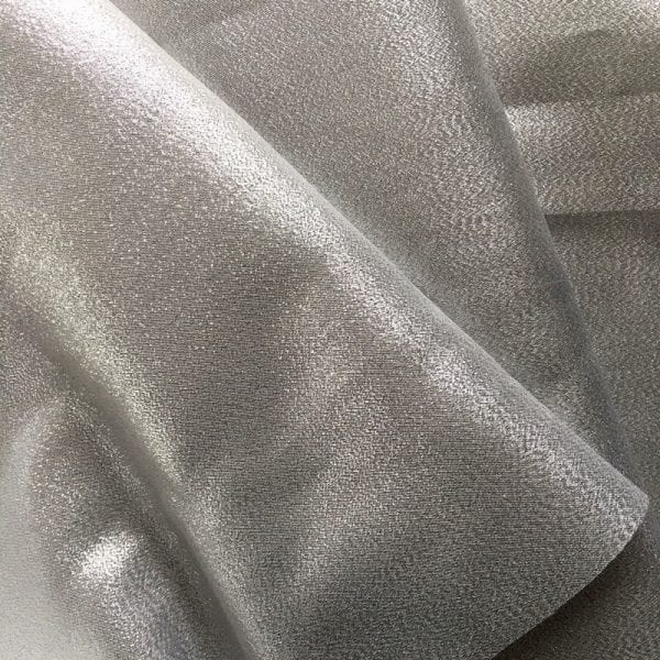 Silver metallic lame fabric featuring a polyester metallic blend for subtle shine and sparkle