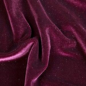 Dance Solid - Burgundy Velvet Fabric At one time only accessible to royalty, velvet is now available to and suited for the everyday and everyone. Velvet is an impressive textile with a rich history going back to the Egyptians. Its unique texture sets it apart from all other fabrics yet it is perfect for so many uses. Our solid velvet features a plush nap and rich colors for a luxurious look and feel. Superb stretch and recovery means it stays with your every move. You will not find a better velvet! Perfect for dance wear, recital, gymnastics, figure skating, costume, cosplay, swimwear, formal wear and anytime you need a dramatic, elegant look.