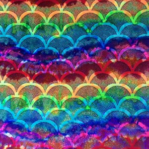 Rainbow Fish Scale Fabric featuring multicolored rainbow stretch base fabric topped with fish scale shaped holographic foil, for brilliant shine and sparkle.