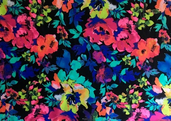 Floral Bouquet - floral print stretch fabric features a vibrant blend of color and abstract floral elements for the upmost in visual interest.  Unique and long-lasting print combined with soft 4-way stretch nylon/spandex blend, makes this an ideal fabric for comfortable and durable swim, beach wear, athletic wear and apparel.