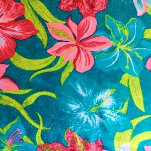 tropical print stretch fabric features a vibrant blend of color and tropical floral elements for the upmost in visual interest.
