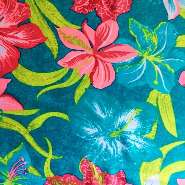 tropical print stretch fabricfeatures a vibrant blend of color and tropical floral elements for the upmost in visual interest.