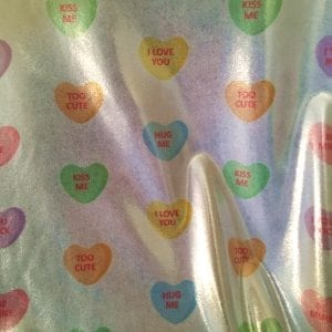 Candy Hearts print fabric on Metallic Sheen