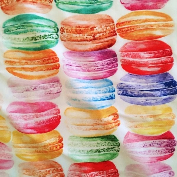 Multicolored french macarons printed on Carvico VITA recycled yarn print base.