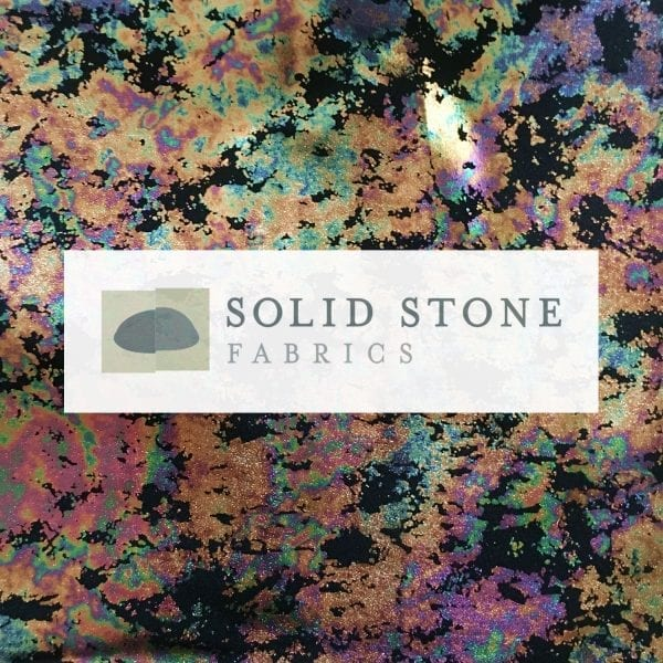 Oil Spill Foil - Multi features distressed oil spill foil on stretch base fabric for a stunning rainbow effect.