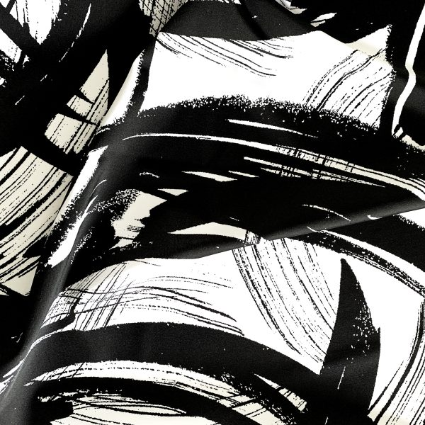 Brushstrokes - black and white brushstroke print stretch fabric features a minimalist brushstroke design in high contrast black and white for the upmost in visual interest.  Unique and long-lasting print combined with soft 4-way stretch nylon/spandex blend, makes this an ideal fabric for comfortable and durable swim, beach wear, athletic wear and apparel.