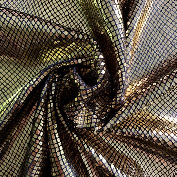 Python - Gold/Black shiny gold snakeskin velvet fabric features plush black 4-way stretch velvet topped with shiny gold snakeskin foil for an ultra-sleek, modern look.