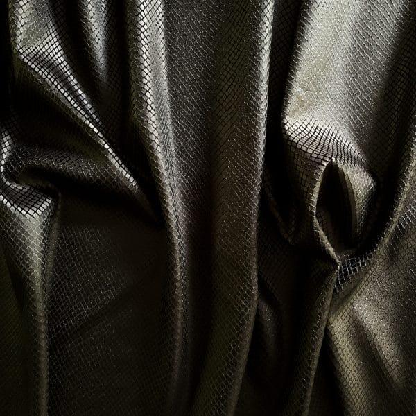 Black snakeskin velvet fabric features plush black 4-way stretch velvet topped with sleek, matte black snakeskin foil for an ultra-sleek, modern look.