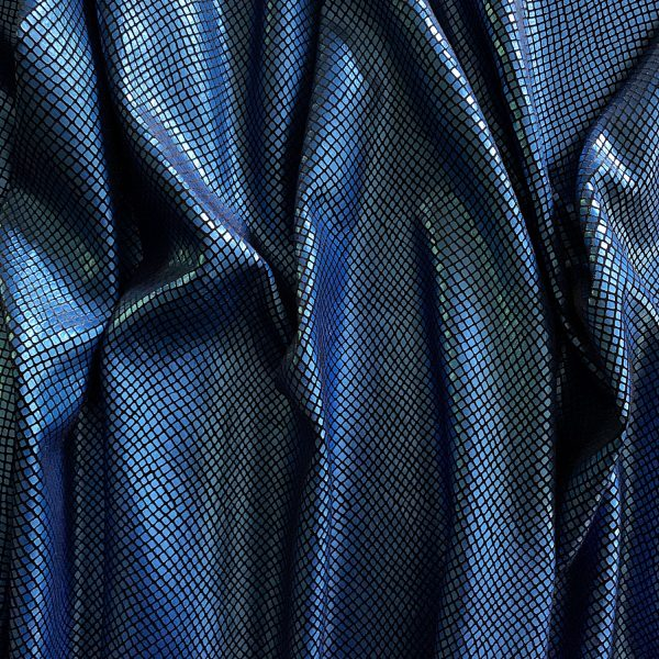 Python - Matte Royal Blue/Black blue snakeskin stretch velvet fabric features plush black 4-way stretch velvet topped with sleek, matte royal blue snakeskin foil for an ultra-sleek, modern look.