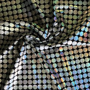 Silver big dot foil fabric featuring black 4-way stretch base fabric topped with silver holographic foil dots measuring 1.5 cm/.59 in in diameter. Especially stunning when combined with motion and light.
