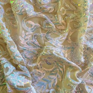 white iridescent sequin mesh fabric featuring 2-way stretch and excellent draping characteristics