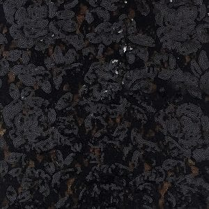Black embroidered floral sequin fabric features stretch base fabric (Nylon/Spandex 88/12) with embroidered sequin flowers for an elegant, glamorous look.