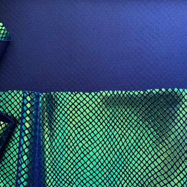Iridescent snakeskin velvet fabric features brilliant, color changing iridescent metallic foil on our premium 4-way stretch Indigo Blue velvet. Superb stretch and recovery means it stays with your every move. Perfect for dance wear, cheer bows, recital, gymnastics, figure skating, costume, cosplay, formal wear and anytime you need a unique, powerful look.